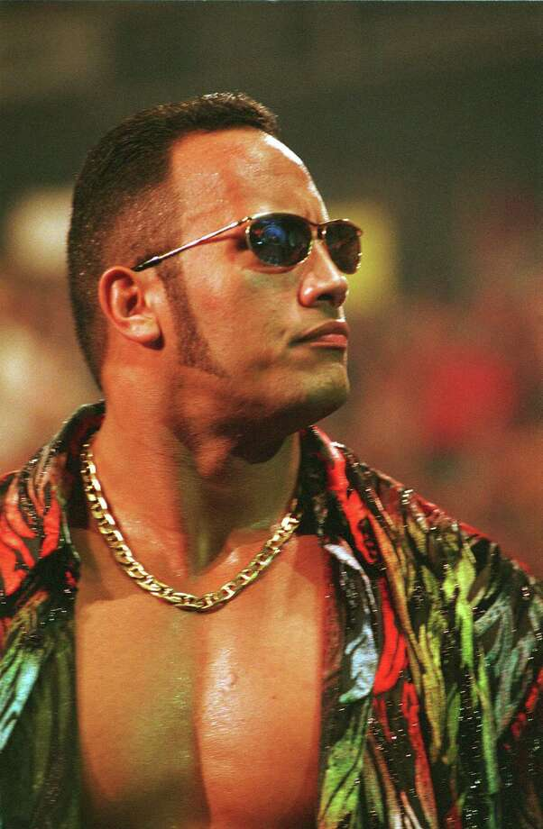 The Rock took his popularity to soaring new heights when he conquered Hollywood too.  Photo: 1999 Titan Sports Inc., UPN