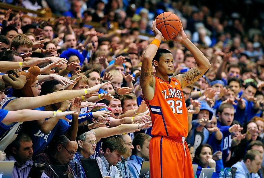 What kind of student attends Duke? The kind who freely offers constructive criticism to opposing players while wearing moose antlers. No wonder Duke is America's eighth-ranked university! (Clemson's K.J. McDaniels gets an earful in Durham, N.C.) Photo: Grant Halverson, Getty Images