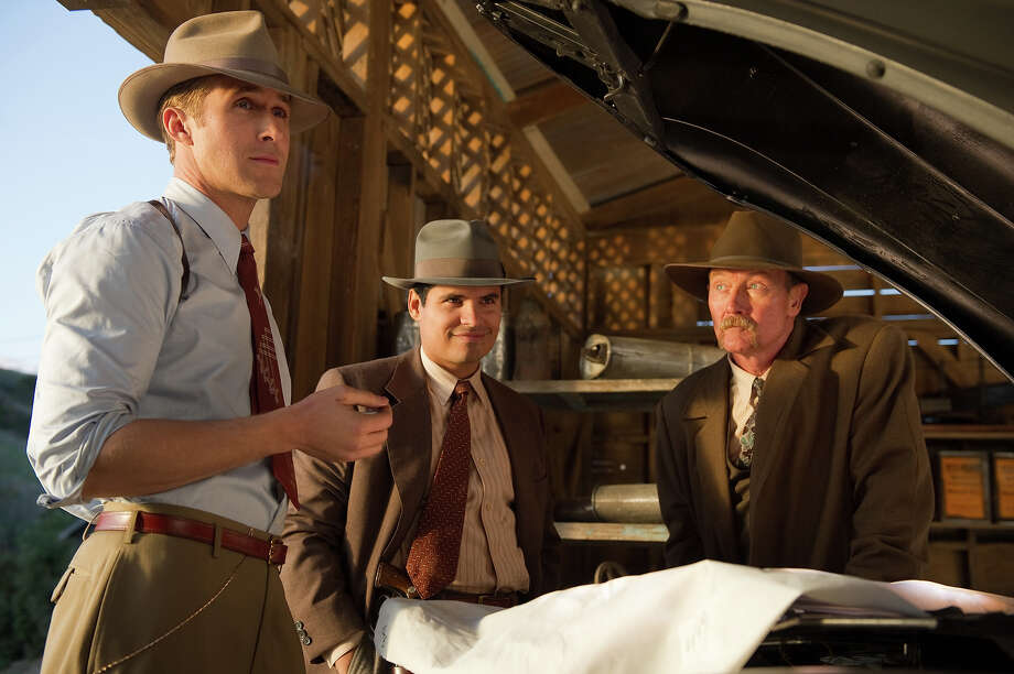 "Ryan Gosling as Sgt. Jerry Wooters, Michael Peña as Officer Navidad Ramirez and Robert Patrick as Officer Max Kennard in Warner Bros. Pictures' and Village Roadshow Pictures' drama  ""Gangster Squad,' a Warner Bros. Pictures release. Photo: Wilson Webb, Warner Brothers / ©2013 Warner Bros. Entertainment Inc. - - U.S., Canada, Bahamas & Bermuda ©2013 Village Roadshow Films (BVI) Limited - - All Other Territories"