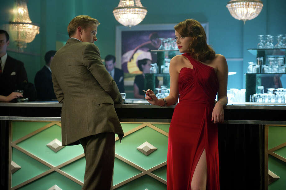 "Ryan Gosling as Sgt. Jerry Wooters and Emma Stone as Grace Faraday in Warner Bros. Pictures' and Village Roadshow Pictures' drama  ""Gangster Squad,' a Warner Bros. Pictures release. Photo: Wilson Webb, Warner Brothers / ©2013 Warner Bros. Entertainment Inc. - - U.S., Canada, Bahamas & Bermuda ©2013 Village Roadshow Films (BVI) Limited - - All Other Territories"