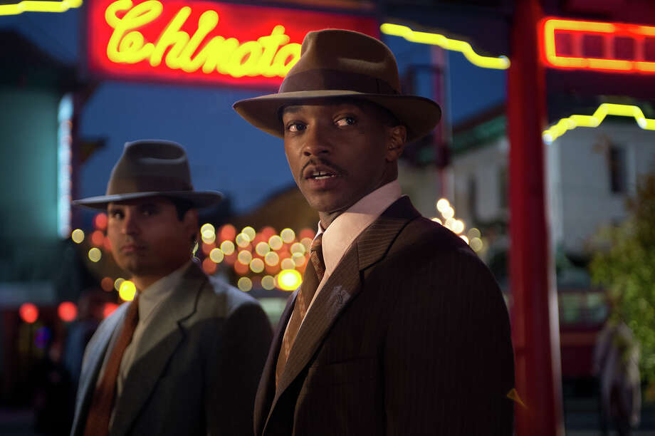 Michael Peña as Officer Navidad Ramirez and Anthony Mackie as Officer Coleman Harris in Warner Bros. Pictures' and Village Roadshow Pictures' drama 'Gangster Squad,' a Warner Bros. Pictures release. Photo: Jamie Trueblood, Warner Brothers / ©2013 Warner Bros. Entertainment Inc. - - U.S., Canada, Bahamas & Bermuda ©2013 Village Roadshow Films (BVI) Limited - - All Other Territories