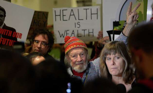 Entertainer and activist Pete Seeger joined hydro fracking opponents in the Empire State Plaza Wednesday, Jan. 9, 2013,  outside the Convention Center in Albany, N.Y., where Governor Cuomo will be deliver his annual State of the State message.  (Skip Dickstein/Times Union) Photo: SKIP DICKSTEIN, ALBANY TIMES UNION / 00020691B