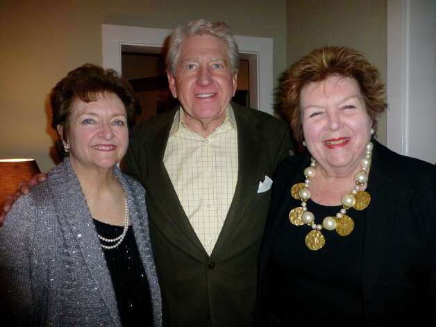 Maggie Houston (from left), Stan McCormick and Sugar Smith celebrate their mutual Jan. 3 birthday at a party the next night. Photo: Nancy Cook-Monroe, For The Express-News