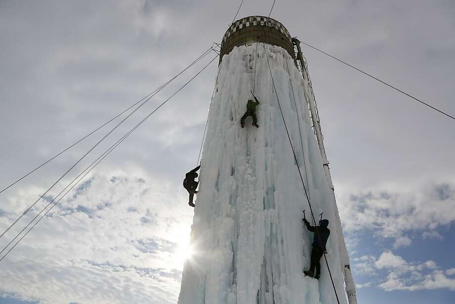 Climbers conquer giant popsicle: Lacking any peak taller than a Walmart, Iowan ice climbers scale an ice-encased silo west of Cedar Falls. Photo: Matthew Putney, Associated Press