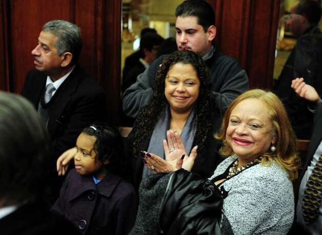 Family members of State Rep. Christina Ayala (D-Bridgeport) witness her swearing in  Wednesday, Jan. 9, 2013 during opening day of the State Legislature at the Capitol Building in Hartford, Conn. Photo: Autumn Driscoll / Connecticut Post