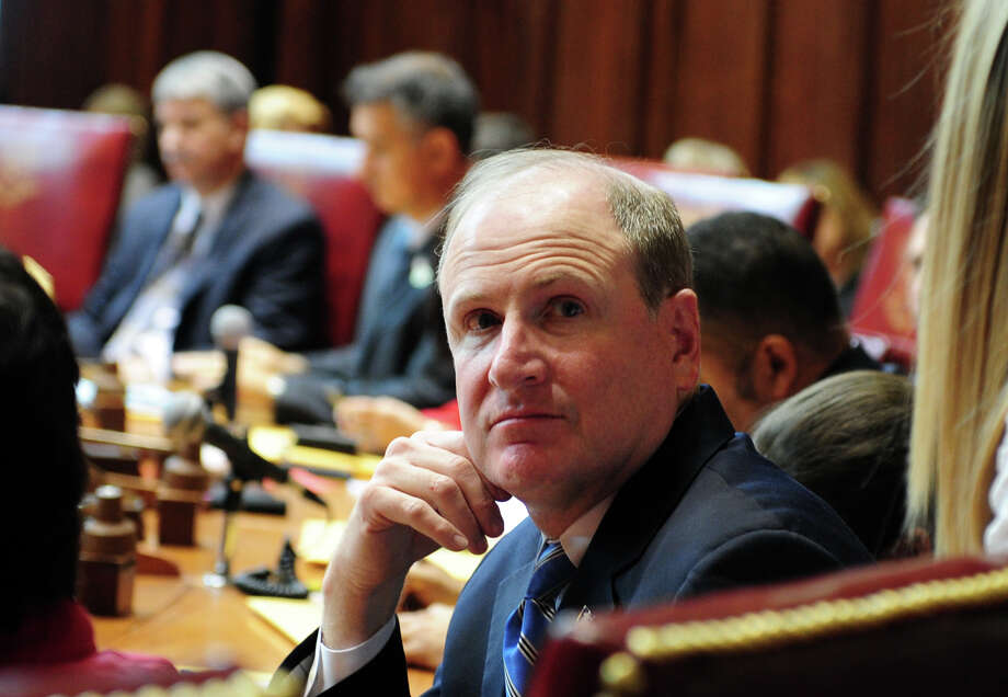 State Sen. Kevin Kelly (R-Stratford) attends opening day of the State Legislature at the Capitol Building in Hartford, Conn. Wednesday, Jan. 9, 2013. Photo: Autumn Driscoll / Connecticut Post
