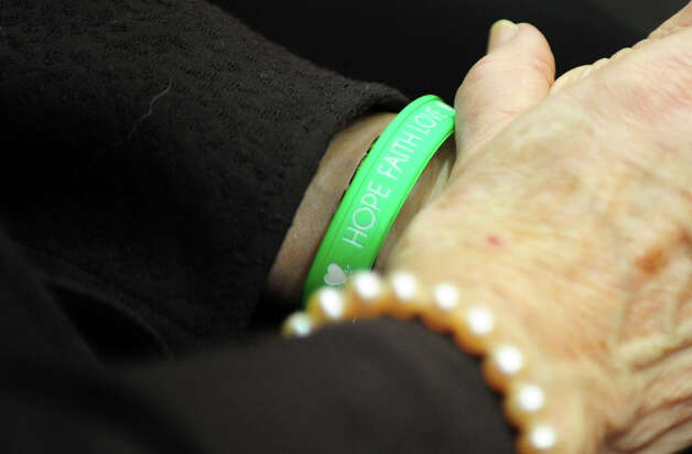Newtown Superintendent of Schools Janet Robinson wears a green and white bracelet as she attends opening day of the State Legislature at the Capitol Building in Hartford, Conn. Wednesday, Jan. 9, 2013. Photo: Autumn Driscoll / Connecticut Post