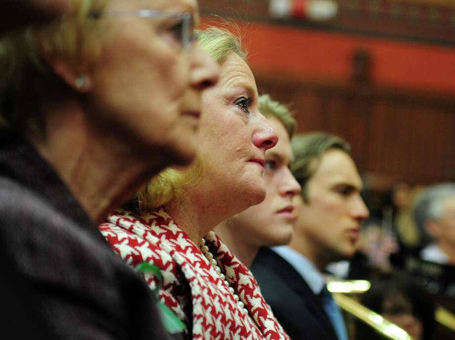 Connecticut first lady Cathy Malloy gets emotional during Gov. Dannel Malloy's State of the State Address Wednesday, Jan. 9, 2013 during opening day of the State Legislature at the Capitol Building in Hartford, Conn. Photo: Autumn Driscoll / Connecticut Post