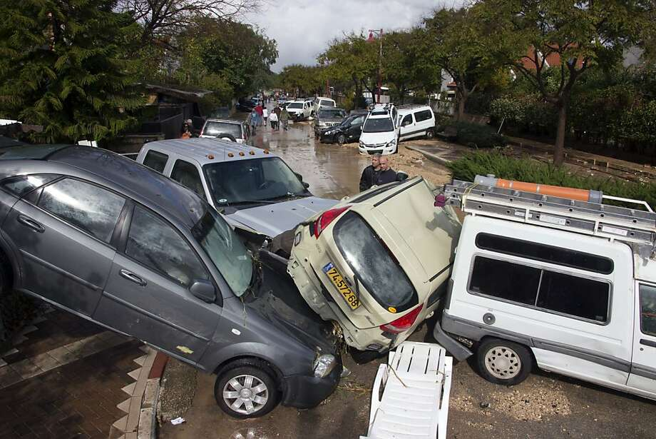 High water, not driver error,was responsible for this pileup in Beit Hefer, Israel. Three days of torrential rains caused heavy flooding in Israel and the Palestinian territories. Photo: Jack Guez, AFP/Getty Images