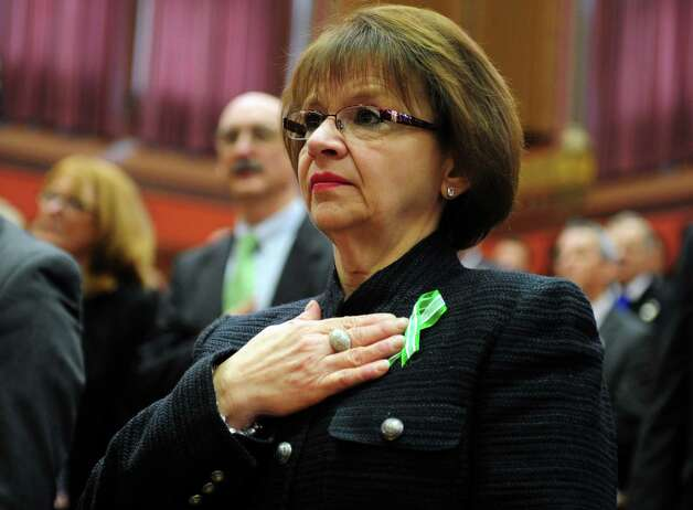 State Rep. Linda M. Gentile (D-Ansonia) stands during the Pledge of Allegiance Wednesday, Jan. 9, 2013 during opening day of the State Legislature at the Capitol Building in Hartford, Conn. Photo: Autumn Driscoll / Connecticut Post