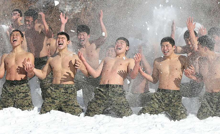 Hypothermia? Bring it on!South Korean special forces soldiers strip off their shirts and spray each other with snow, a winter drill tradition in Pyeongchang. Photo: Dong-a Ilbo, AFP/Getty Images