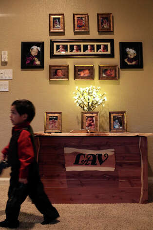 Jace Villarreal, 3, walks by a memorial to his sister, Laura, at his home in San Antonio on Friday, Jan. 4, 2012. Laura passed away at the age of six months and 12 days on Dec. 2, 2012, shortly after the discovery of an aggressive brain tumor. Photo: Lisa Krantz, San Antonio Express-News / © 2012 San Antonio Express-News