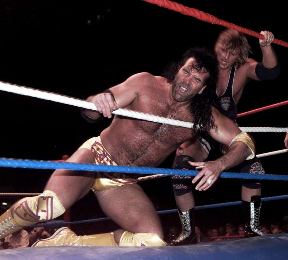 "Razor Ramon (bottom) and the late Owen Hart were some of the original superstars when RAW was called ""Monday Night Raw."" Photo: LARRY MACDOUGAL, AP / CALGARY HERALD"
