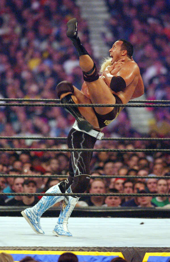 Hulk Hogan slams The Rock at Wrestlemania X8. The Rock would go on to win.  Photo: MARK O'NEIL, AP / TRSUN