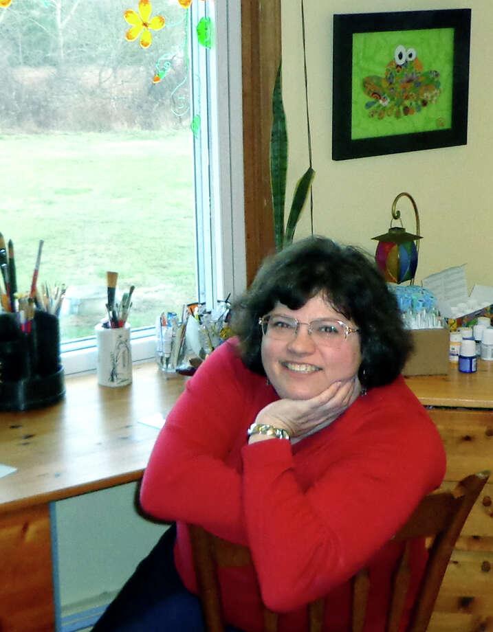 Artist Elizabeth Scheglov creates eye-catching images at her home studio in New Milford. December 2012   Courtesy of Elizabeth Scheglov Photo: Contributed Photo