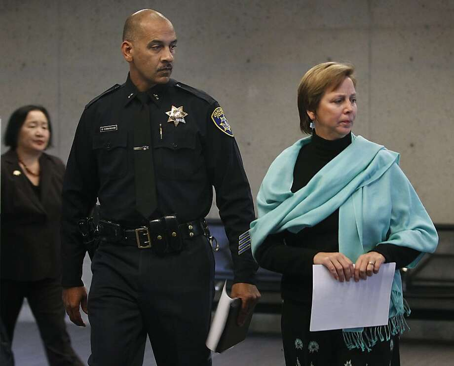 Museum director Lori Fogarty (right) leads police Lt. Oliver Cunningham and Mayor Jean Quan to a news conference to detail the theft of a second exhibit made of gold at the Oakland Museum of California in Oakland, Calif. on Wednesday, Jan. 9, 2013. Authorities are investigating two separate thefts of gold artifacts from November of last year and this past Monday. Photo: Paul Chinn, The Chronicle