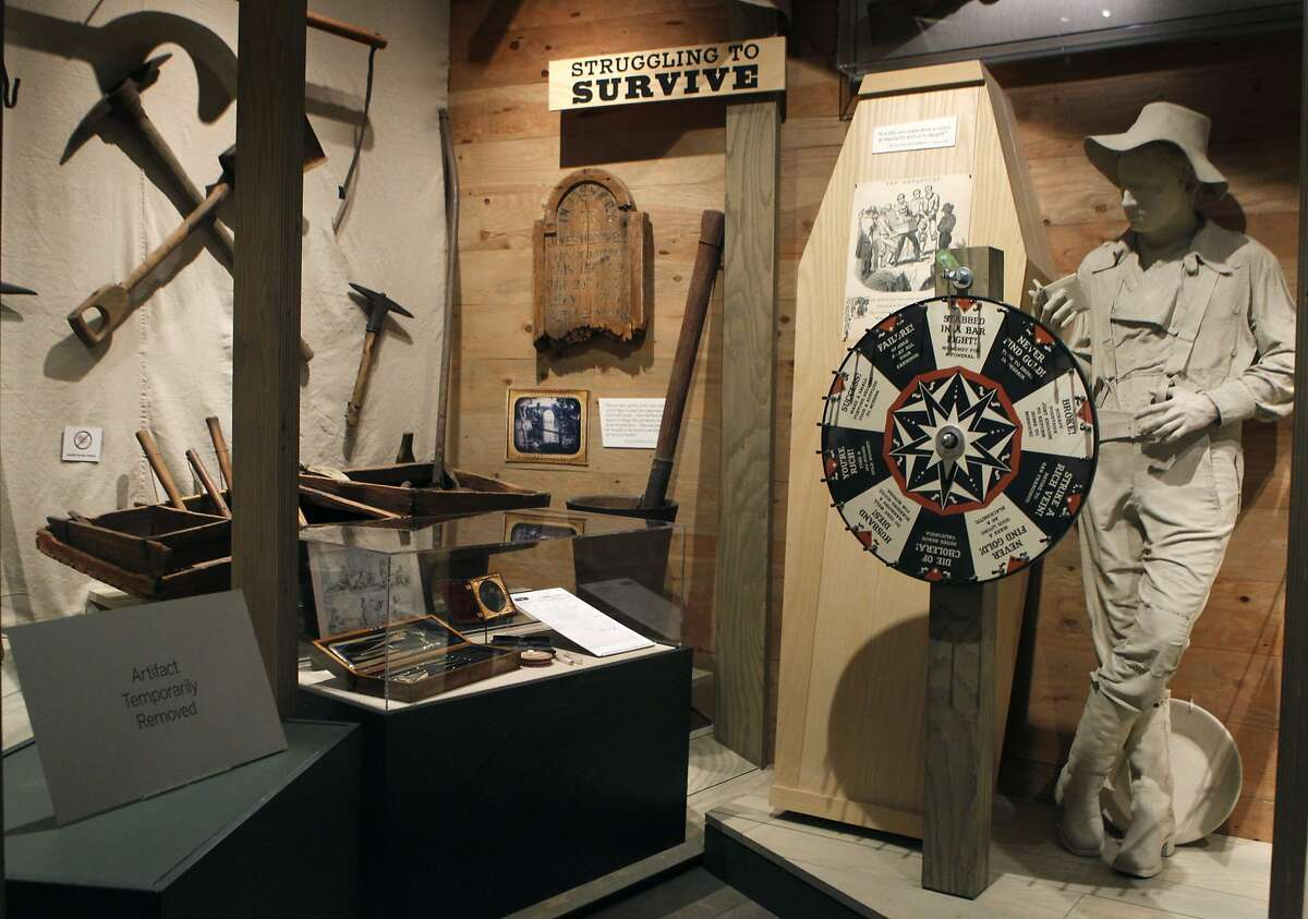 A sign (lower left) informs visitors that an artifact, stolen from a burglary last year, remains missing at the Oakland Museum of California in Oakland, Calif. on Wednesday, Jan. 9, 2013. Authorities are investigating two separate thefts of gold artifacts from November of last year and another one this past Monday.