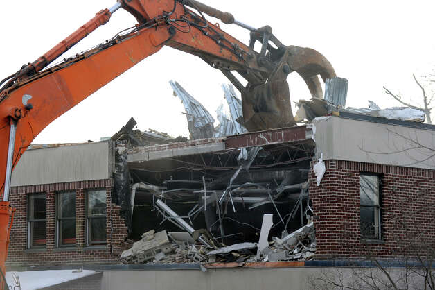 Demolition of the old Ridgefield Library begins shortly after 9 a.m. Wednesday morning, January 9, 2013. Photo: Carol Kaliff / The News-Times