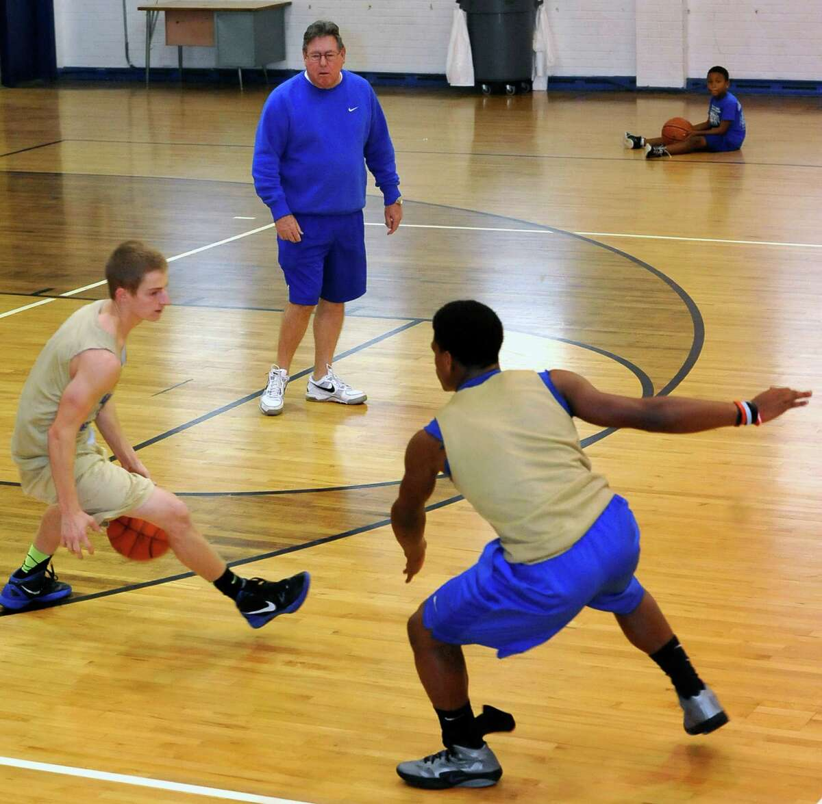 New head basketball coach at Hamshire-Fannett High School, Tommy Collins, top, held a practice on New Years Eve in an older gym while the boy's gym was having the floor re-finished. Dave Ryan/The Enterprise