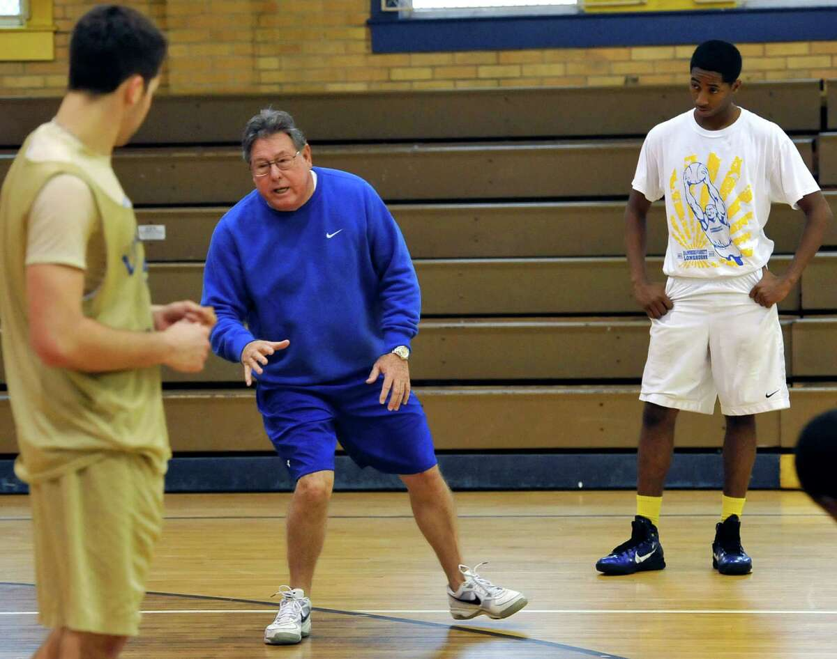 New head basketball coach at Hamshire-Fannett High School, Tommy Collins, center, held a practice on New Years Eve in an older gym while the boy's gym was having the floor re-finished. Dave Ryan/The Enterprise