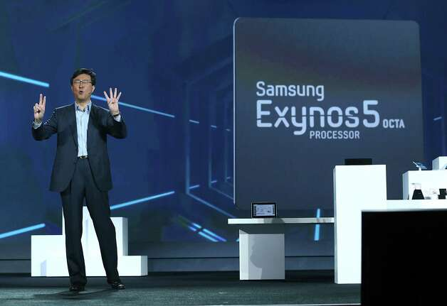 LAS VEGAS, NV - JANUARY 09:  Dr. Stephen Woo, Samsung Electronics President, Device Solutions Business speaks during a keynote address at the 2013 International CES at The Venetian on January 9, 2013 in Las Vegas, Nevada. CES, the world's largest annual consumer technology trade show, runs through January 11 and is expected to feature 3,100 exhibitors showing off their latest products and services to about 150,000 attendees. Photo: Justin Sullivan, Getty Images / 2013 Getty Images