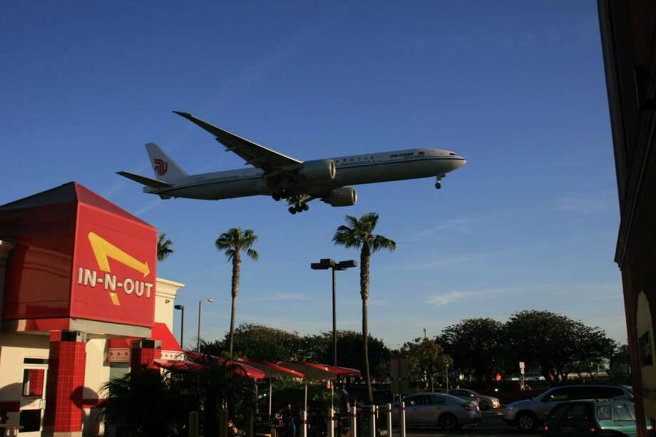 An Air China Boeing 777 descends to Los Angeles International Airport in March 2012. Photo: Bill Montgomery