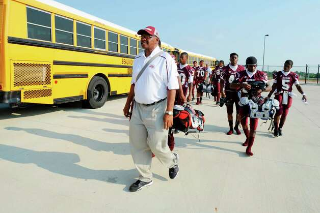 Central head football coach Andrew Washington leads his players to the home team locker room at the BISD Thomas Center for the season opener against Port Arthur Memorial.  Friday, August 26, 2011  Valentino Mauricio/The Enterprise Photo: Valentino Mauricio