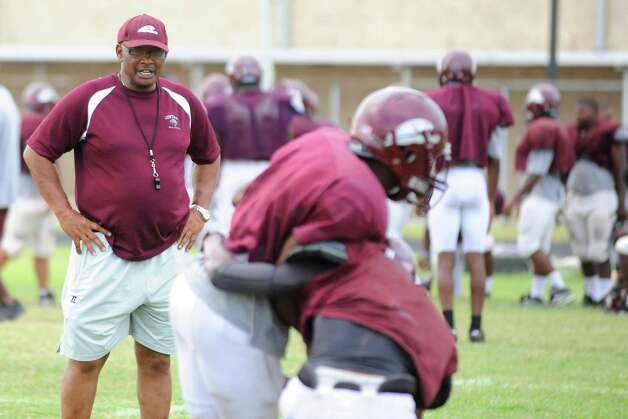 Central High School head football coach Andrew Washington, left, works with his team during  a District 20-4A bye week as it prepares for their crosstown rivalry against Ozen on Sept. 24.  Valentino Mauricio/The Enterprise Photo: Valentino Mauricio / Beaumont
