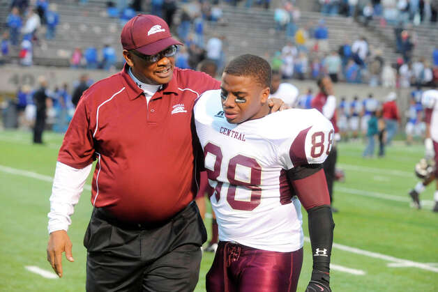 Central head coach Andrew Washington, left,  comforts one of his players, senior Johnathan Fonteneaux, after the Jaguars 44-22 loss to the Friendswood Mustangs in the third round of playoffs at Baytown's Stallworth Stadium on Saturday.  Valentino Mauricio/The Enterprise Photo: Valentino Mauricio / Beaumont
