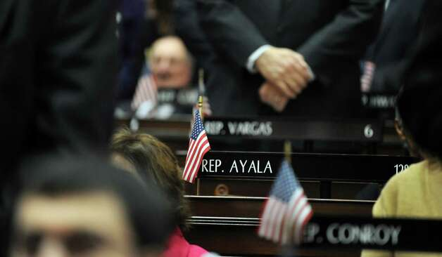 State Rep. Christina Ayala's (D-Bridgeport) seat remains empty at the start of opening day of the State Legislature at the Capitol Building in Hartford, Conn. Wednesday, Jan. 9, 2013. Photo: Autumn Driscoll / Connecticut Post