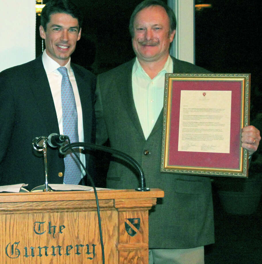 Peter Becker, left, head of school at The Gunnery in Washington, presents Washington First Selectman Mark Lyon with a ìFriend of the Green Awardî during a town party hosted by the local prep school.  Courtesy of The Gunnery Photo: Contributed Photo