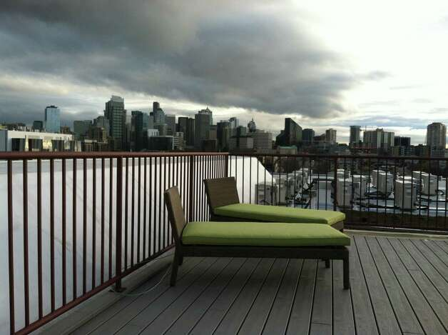 Rooftop deck of Stream Uptown, a new lower Queen Anne apartment building that boasts of being the first residential building in Seattle to fully mitigate its carbon footprint for construction, and ongoing operation and maintenance. Photo: Stream Real Estate LLC