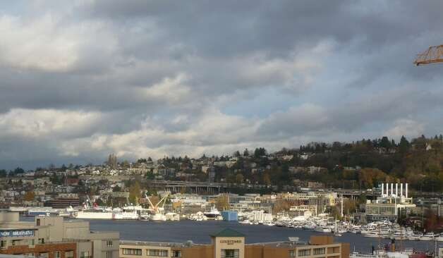 View of Lake Union from rooftop deck of Stream Uptown, a new lower Queen Anne apartment building that boasts of being the first residential building in Seattle to fully mitigate its carbon footprint for construction, and ongoing operation and maintenance. Photo: Stream Real Estate LLC