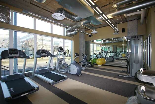 Fitness studio of Stream Uptown, a new lower Queen Anne apartment building that boasts of being the first residential building in Seattle to fully mitigate its carbon footprint for construction, and ongoing operation and maintenance. Photo: Stream Real Estate LLC