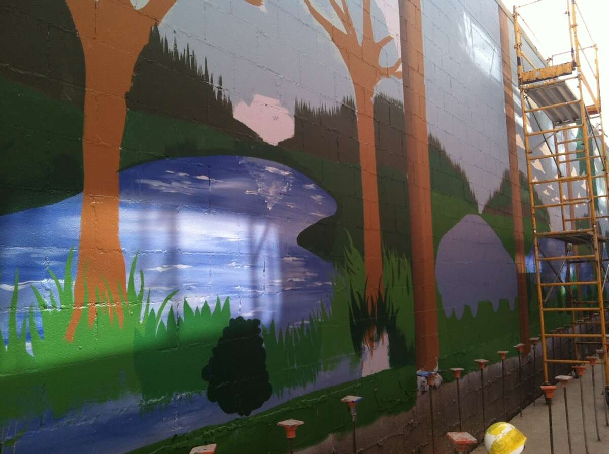 Mural of Stream Uptown, a new lower Queen Anne apartment building that boasts of being the first residential building in Seattle to fully mitigate its carbon footprint for construction, and ongoing operation and maintenance.