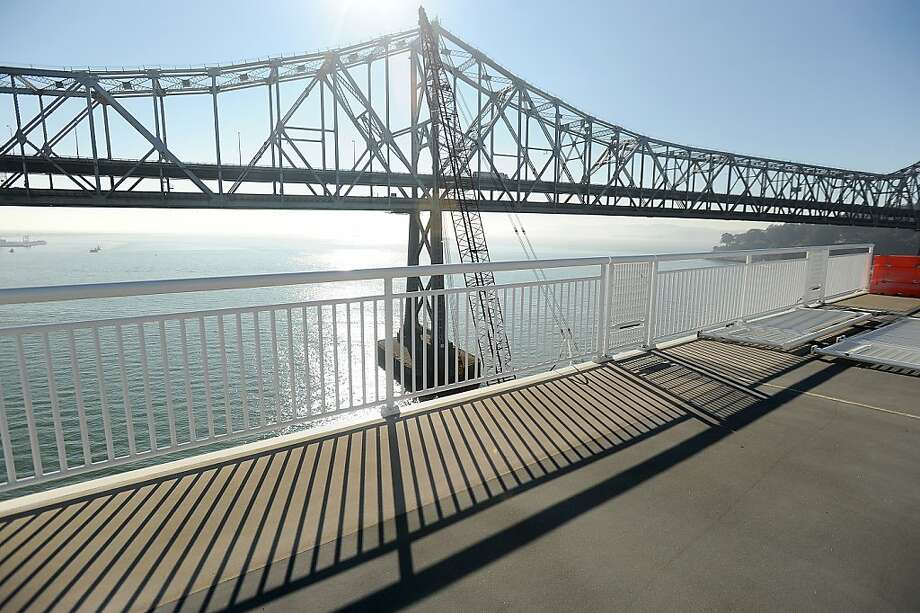 An error by welders means that every bolt securing the railing along the new span's bike path will have to be inspected. Photo: Noah Berger, Special To The Chronicle