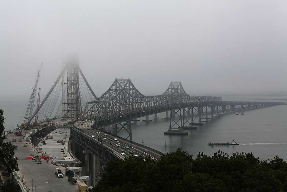 Fog hovers over the new eastern span of the Bay Bridge on Friday, Sept. 28, 2012. Caltrans may replace 288 giant bolts on the span as several have snapped. Photo: Liz Hafalia, The Chronicle