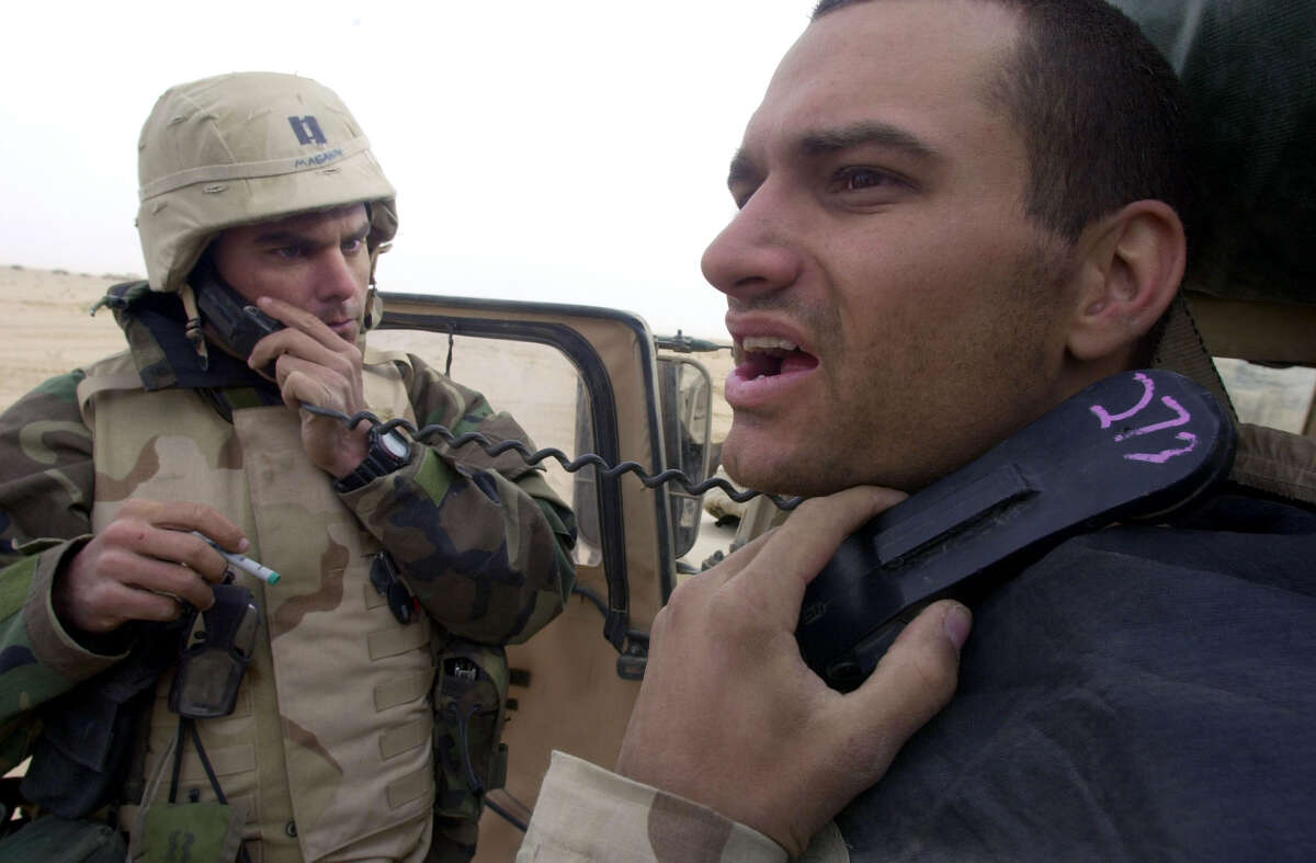 Air Force tactical air controllers Capt. Shad Magann (FL), left, and Sgt. Travis Crosby (GA) control the air from their humvee as they send nine morning missions to bomb targets in a region north of them Monday, March 24, 2003 in South Central Iraq.