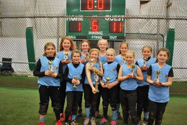 The East Greenbush U10 Express softball team poses with their championship trophy. Team members are, from left:  Bella LaFreniere of West Sand Lake, McCayla Burns of East Greenbush, Ashley Angelo of Castleton, Abby Farnan of East Greenbush, Taylor O?Brien of East Greenbush, Alexis O?Brien of Castleton, Karley Duda of Wynantskill, Hannah Scarano of East Greenbush, Emma Scheeren of West Sand Lake, Maddie Ingoldsby of Rensselaer and Maeve Marra of Troy.