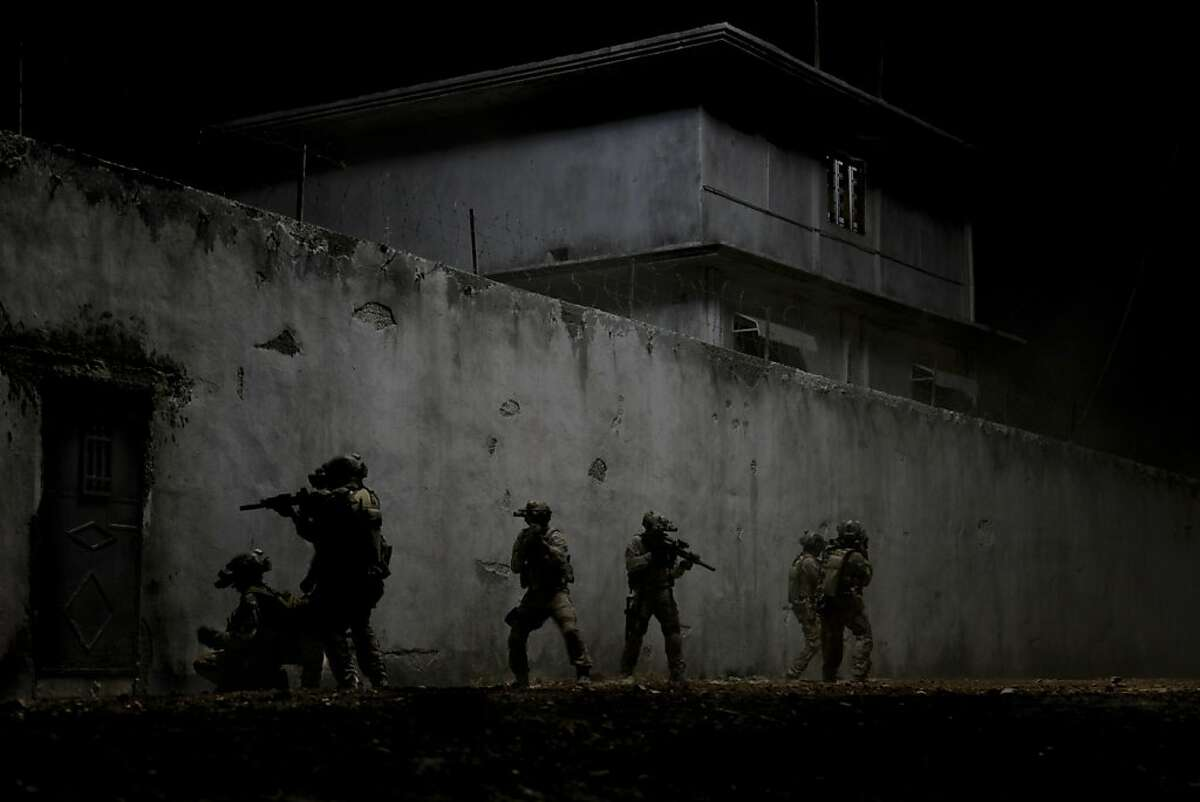 """FILE - This undated publicity film image provided by Columbia Pictures Industries, Inc. shows elite Navy SEAL's raiding Osama Bin Laden's compound in the dark night in Columbia Pictures' gripping new thriller directed by Kathryn Bigelow, """"Zero Dark Thirty."""" Steven Spielberg has extended his domination at the Directors Guild of America Awards, earning his 11th film nomination Tuesday, Jan. 8, 2013, for his Civil War epic """"Lincoln."""" Also nominated were past winners Kathryn Bigelow for her Osama bin Laden thriller """"Zero Dark Thirty""""; Tom Hooper for his musical """"Les Miserables""""; and Ang Lee for his lost-at-sea story """"Life of Pi."""" Rounding out the lineup is first-time nominee Ben Affleck for his Iran hostage crisis tale """"Argo."""" (AP Photo/Columbia Pictures Industries, Inc., Jonathan Olley, File)"""
