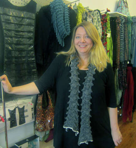 Shop owner Annie Nast offers a welcoming smile to patrons of Daffodil 6, a boutique on Bank Street in New Milford. November 2012 Photo: Norm Cummings