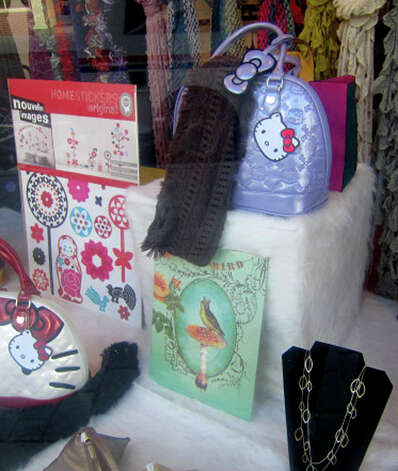 The front window display reflects the wide variety of items offered at Daffodil 6, a boutique on Bank Street in New Milford. November 2012 Photo: Norm Cummings