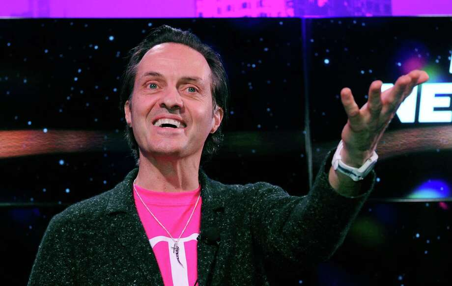 T-Mobile President and CEO John Legere speaks at a news conference at the 2013 International Consumer Electronics Show at The Venetian on January 8, 2013 in Las Vegas. Photo: David Becker, Getty Images / 2013 Getty Images