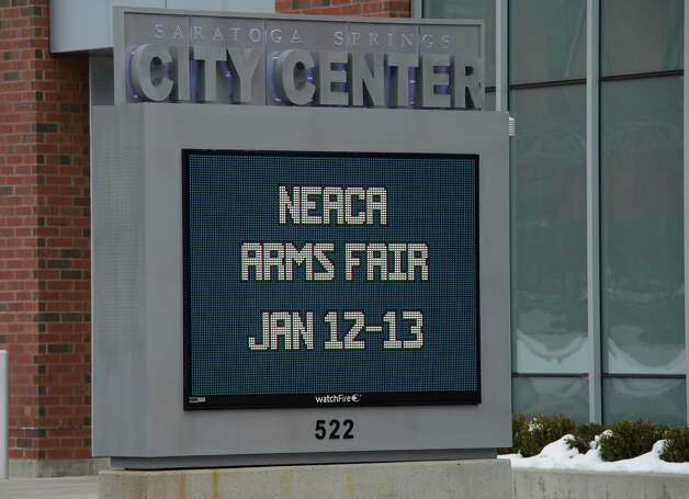 Sign outside of the Saratoga's City Center promotes the upcoming NEACA Arms Fair,  Wednesday morning, Jan. 9, 2013, in Saratoga Springs, N.Y.  (Skip Dickstein/Times Union) Photo: SKIP DICKSTEIN / 00020710A