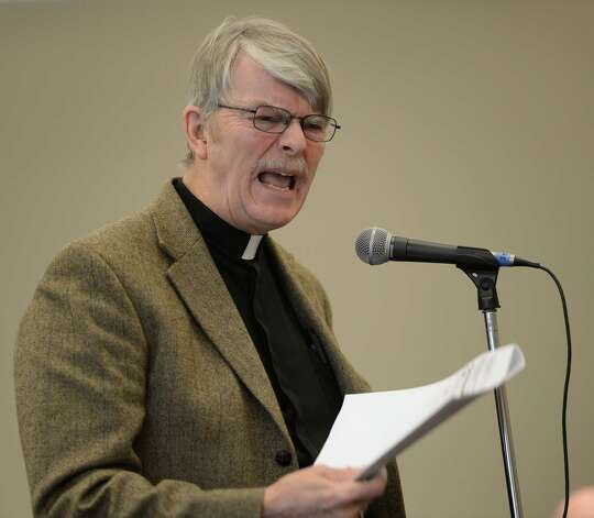 The Rev. Jay Eckman speaks out against the holding of this weekend's gun show during an open meeting of the City Center Board Wednesday morning, Jan. 9, 2013, in Saratoga Springs, N.Y.  (Skip Dickstein/Times Union) Photo: SKIP DICKSTEIN / 00020710A