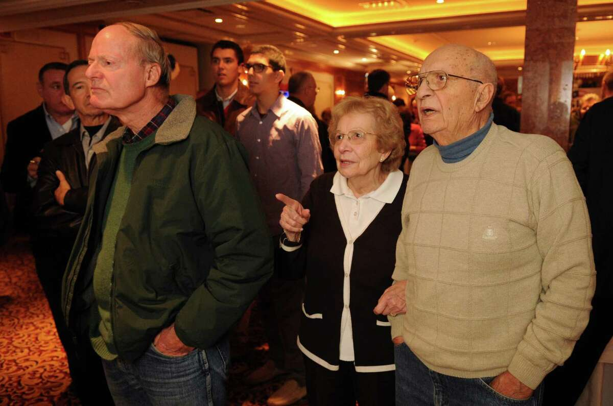 Louise Esposito, center, and her husband, former Norwalk Mayor Frank Esposito, watch election results come in on television at the Norwalk Inn in Norwalk, Conn., on Tuesday, Nov. 6, 2012.