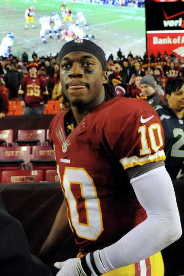 Washington Redskins quarterback Robert Griffin III looks back across the field after an NFL wild car