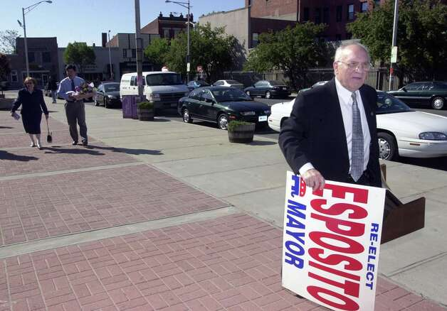 Norwalk_050701_Norwalk mayor Frank Esposito carries a campaign sign to a press conference where he announced that he will run for re-election next fall.  Kerry Sherck/Staff photo Photo: Kerry Sherck, NWK