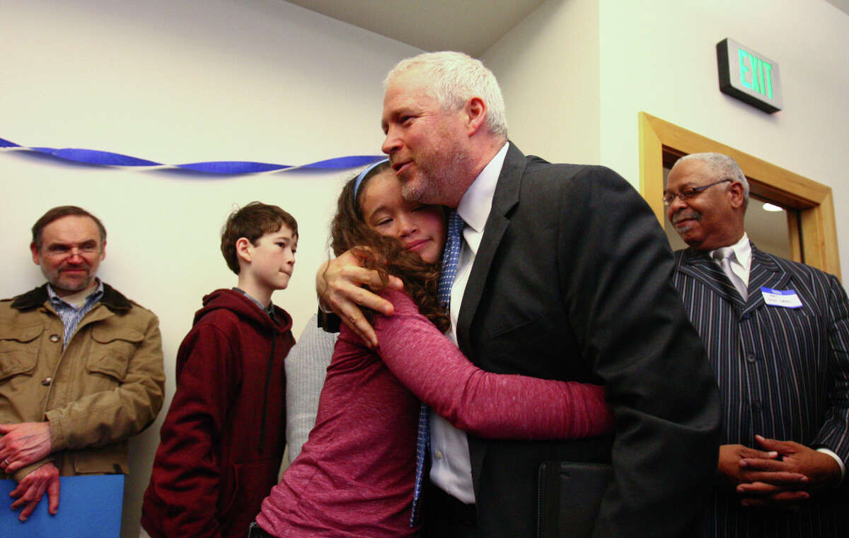 Seattle Mayor Mike McGinn is embraced by his daughter Miyo, 15, after he announced he will seek a second term on Wednesday, January 9, 2013 at the Filipino Community Center on Martin Luther King Jr. Way South in Seattle. McGinn announced during the event that he is jumping into the race for a second term as mayor of Seattle.
