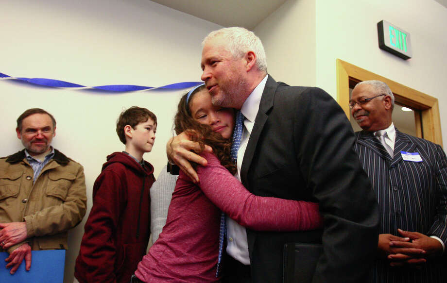 Seattle Mayor Mike McGinn is embraced by his daughter Miyo, 15, after he announced he will seek a second term on Wednesday, January 9, 2013 at the Filipino Community Center on Martin Luther King Jr. Way South in Seattle.  McGinn announced during the event that he is jumping into the race for a second term as mayor of Seattle. Photo: JOSHUA TRUJILLO / SEATTLEPI.COM